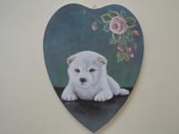 ペットロスの方がペットのリアルな似顔絵の注文(オーダー)前に見る作品~薔薇の花のそばで横たわる仔犬を立体感を出して描いた肖像画のグッズ
